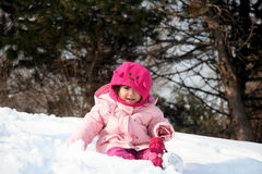 Playing in the Snow. Girl playing in the snow Stock Images