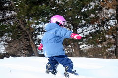 Playing in the Snow. Girl playing in the snow Royalty Free Stock Photo