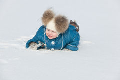 Playing in the snow field Stock Images