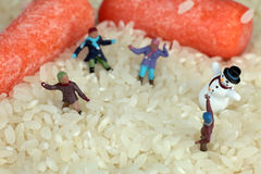 Playing snow figures on white rice Stock Photo