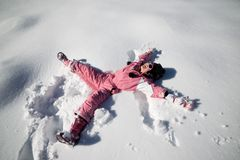 Playing in the snow. Little girl playing in the snow, Pyrenees, Spain Royalty Free Stock Photography