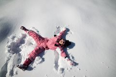 Playing in the snow. Little girl playing in the snow, Pyrenees, Spain Stock Photos