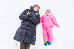Playing in snow. A mother and child playing in snow, having fun during winter Royalty Free Stock Photo