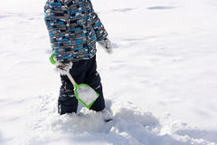 Playing in the snow with a shovel. Stock Photos
