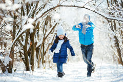 Playing in the snow in winter Royalty Free Stock Photo