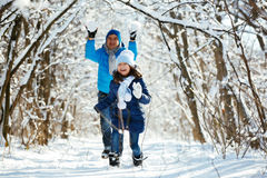 Playing in the snow in winter Royalty Free Stock Photos