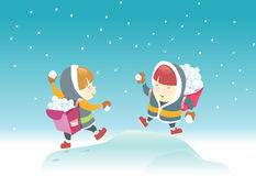 Playing Snowball. Two kids aiming at each other for snowball fight Royalty Free Stock Photography