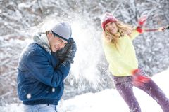Playing snowballs Royalty Free Stock Image