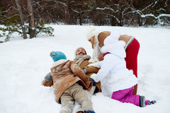 Playing in snowdrift royalty free stock images