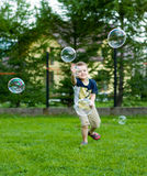 Playing with soap bubbles Royalty Free Stock Image
