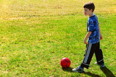 Playing soccer Royalty Free Stock Image