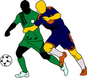 Playing Soccer. Two silhouettes of soccer players go after the ball Stock Images