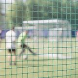 Playing soccer game on sports field, football match on pitch. Fight for a soccer ball at the sports gate. Football. Outdoor stadium. Blurred image for Royalty Free Stock Images