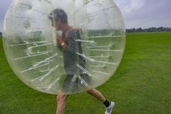 Playing soccer in a plastic bubble. Playing soccer in a bumperball, a new funsport in Copenhagen, Denmark - July 27, 2017 Stock Photography