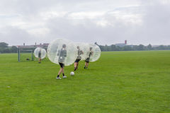 Playing soccer in a plastic bubble, zorbsoccer. Playing soccer in a bumperball, a new funsport in Copenhagen, Denmark - July 27, 2017 Stock Photos