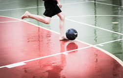 Playing soccer in the rain Royalty Free Stock Photos