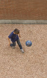 Playing soccer. A young boy is playing soccer, view from above Royalty Free Stock Images