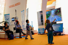 Playing somatic game,2013 WCIF. In the user experience zone kids were amused by motion sensing games on 2013 WCIF.As a state-level international exposition,the Stock Image