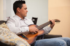 Playing some music at home Royalty Free Stock Image