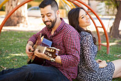 Playing a song for my girlfriend Stock Images