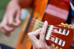 Playing spanish guitar royalty free stock photo