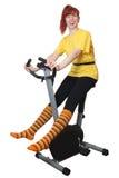 Playing sports on a velosimulator Royalty Free Stock Photo