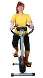 Playing sports on a velosimulator. The young woman goes in for sports on a velosimulator. A white background Stock Images