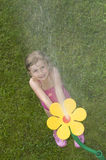 Playing with sprinkler Stock Images