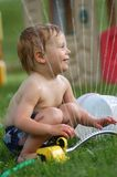 Playing In A Sprinkler Stock Image