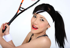 Playing squash. Young asian woman playing squash Stock Images