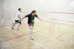 Playing squash Stock Photo