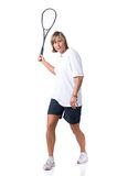 Playing squash. Full isolated picture of a  caucasian woman playing squash Royalty Free Stock Photo