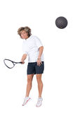 Playing squash. Full isolated picture of a  caucasian woman playing squash Royalty Free Stock Images