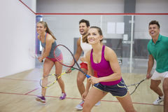 Playing squash with friends. Affectionate friends during the squash game Stock Images