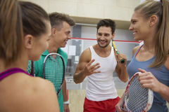 Playing squash with friends. Consult a strategy game with friends Royalty Free Stock Photo