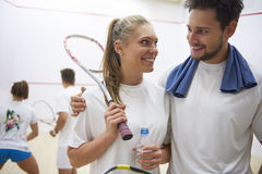 Playing squash with friends. Couple during the match of squash Royalty Free Stock Photo