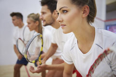 Playing squash with friends. Squash demands a lot of focus Royalty Free Stock Photo