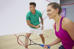 Playing squash with friends Royalty Free Stock Photo