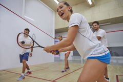 Playing squash with friends. Good cooperation is very important during the game Royalty Free Stock Images