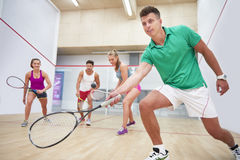 Playing squash with friends. Good way to spend time with friends Royalty Free Stock Photo