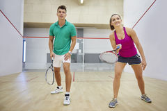 Playing squash with friends. This is a good way to spend time actively Royalty Free Stock Photo