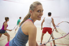 Playing squash with friends. Group of friends playing in squash Royalty Free Stock Images