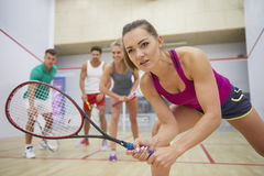 Playing squash with friends Stock Images
