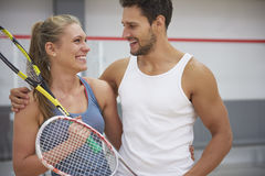 Playing squash with friends. Happy couple after the match Stock Photos