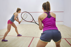 Playing squash with friends Royalty Free Stock Photos