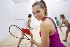 Playing squash with friends. We have to win today Stock Photography