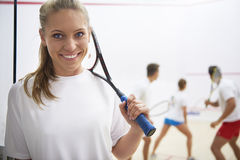 Playing squash with friends. This is how she spends time with her friends Stock Image