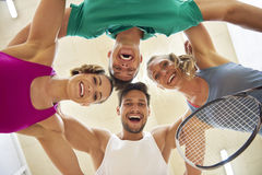 Playing squash with friends. Low angle view of squash players Royalty Free Stock Photos