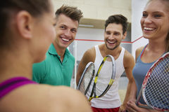 Playing squash with friends. Meeting of friends at the healthy club Royalty Free Stock Photo