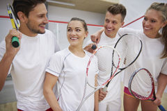 Playing squash with friends. Planning the method of victory Stock Image